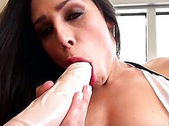 Anastasia Morna plays with a huge dildo