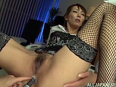 Reiko is a very bad girl and she loves to have things shoved up in her holes. Her sexy girlfriend helps her stick sex toys in both her tight anus and her wet pussy. She moans with pleasure, as she gets close to orgasm from the toying.