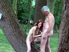 Teen redhead blows a dirty old man outdoors