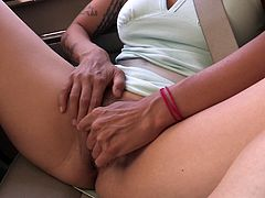 Sexy women gets naughty in the car with pussy show