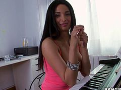 Brunette finishes playing piano and undress her top displaying her natural tits before getting her hairy pussy logged hardcore on floor