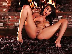 Close up of a babe by the fireplace