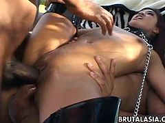 She is a sizzling hot Thai slut who has a fuck with two aroused dudes. She is tied up by her neck and the fuck is too damn hot as she receives her DP.