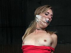 The last thing that executor Jack wants his submissives doing, is talking or opening their mouths, unless they're going to suck his cock. Mona has her hands bound and is placed on her knees. He puts a mouth guard in her mouth and wraps it with plastic. Next, he puts a bag over her head and suffocates her.