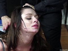 Aspen has had an interest in getting dominated, but she didn't know what she was in for, when she got with Tommy. He pulls her hair and makes her throat his dick, then ties her to the bed, bent over. He has to take a break for a call, then it's back to the session. After gagging her, the whipping begins.