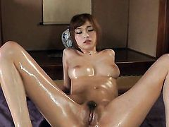 Milf kills time dildoing her love tunnel for camera