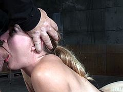 Mona's a sexy blonde bitch, who got enslaved and bonded in a basement. Alone with two horny men, this hot slut is about to get awfully used, to satisfy their kinky desires. See her mouth fucked and banged hard!