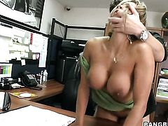 Huge tits bounce on the table