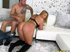 Melissa is a gorgeous, horny blonde with a few places for a man to get a good grip, while he's mashing her box with his fuck stick. She drops to her knees with ease and starts sucking his dick, then rides him good, while getting her big ass spanked. He bends her over for some more rough drilling.