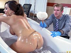 This doctor has rolled this hot nude milf into the operating room, but before he diagnoses her, she needs to be bathed. The hot slut gets in the tub and he rubs the soapy water all over her massive tits.