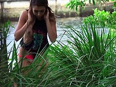 Horny Melissa has no clue that a man followed her and continues to watch her every move, enjoying the kinky way she's playing with her cunt, while laying on the grass, legs widely spread. Click to see what this naughty lady is up to, when she spots the daring stalker!
