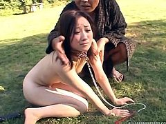 These dirty girls are in trouble and they need to be humiliated, and treated like sluts. The masters put them on their leashes and make them crawl around outside on the grass. They have huge dildos, shoved into their holes, so they get stretched out.