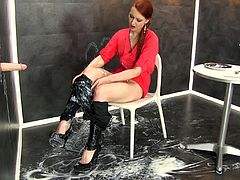 This redhead cutie walked into the room and spotted a hard cock, sticking out of the gloryhole. She jacked it off and it soon spurted cum all over the floor. The cock kept cumming and cumming, as she sat in the chair and played with her pussy.