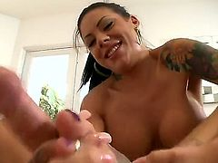 Mason Moore is a tattooed brunette with huge tits. She is using her feet to jack a guy off. Then she is seen using her mouth and she swallows all that comes out.