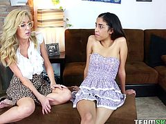 Nerd girl in a flirty skirt seduces a sweet lesbian teen