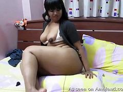 She is on my bed, rubbing her tits and showing off her coochie. This fat black chick hasn't been laid in years, but first I am going to enjoy the show. She twerks and teases me, hoping that I will join her and fuck her black cunt so hard.