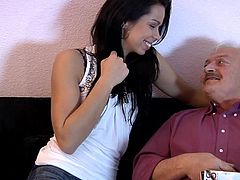 Petra does charity work for seniors, although not the type that would get well-rewarded and regarded by most people. See, her charity involves getting an old man a good nut from a young slut. After putting up his Christmas tree, the little ho sits by him on the couch, kissing and feeling him up.