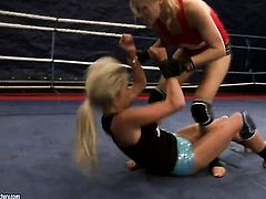 Blonde Michelle Moist gets her cunt rubbed to orgasm by Laura Crystal in lesbian action
