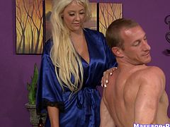 Fake boobs masseuse gives a rubdown and gets fucked