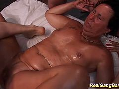 extreme oiled stepmom in her first wild gangbang bukkake fuck party orgy