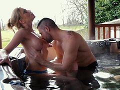 This blonde hot milf with gazelle body, is relaxing in a large jacuzzi, outdoor. When her partner joins in, she is more than excited, as the man starts playing with her fantastic boobs in a kinky way. Watch Holly sucking cock and banged hard, from behind!