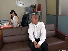 Secretary in pantyhose strokes his dick in the office