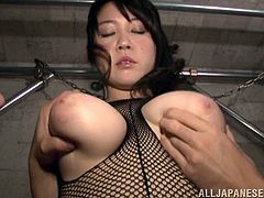 Wouldn't you just love to suck on her gigantic boobs. Today these two lucky guys get to do that. Her breasts are perfectly round and natural. The Japanese beauty looks absolutely stunning in her fishnet outfit. She is ready for a hard and fast fingering now.