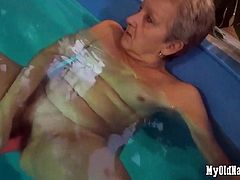 Granny in the pool with dildo inflatable