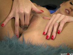 Silvie Deluxe, elegant European super model, fingers her shaved pussy with the Hotgvibe cock ring until the sex toy gives her a deep, penetrating orgasm.