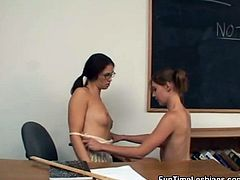 Shapely and adorable lesbians give each other oral sex in the lecture room
