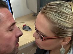 Blonde haired MILF with glasses Barra Brass gets down on her knees in front of coworker and unbuttons her blouse. She has a good time playing with his hard cock in the office.