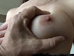 There are tan lines of her beautiful natural tits. Topless girl shows off her boobs. Man has a good time playing with her breasts. But theres another naughty girl with sexy knockers.