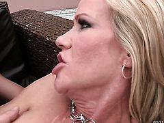 Simone Sonay with giant knockers squeezes the cum out of David Perrys worm with her lips while giving headjob after she gets her fudge packed