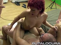 A young pink-haired Spanish babe wanted to try something new, so she decided to participate in a gangbang... and she loved it!