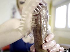 Candy May - Gives handjob to BBC with a latex glove