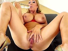 Kianna Dior likes to play with her shaved pussy and her huge tits. The Asian milf displays her legs as her pussy get stretched by a large dildo. Check her out.