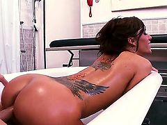 Gia Dimarco is a huge tits patient that is being massaged by her doctor. What he is doing is very helpful to her condition - she is a real nympho that wants sex all the time.