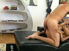 A skinny girl is resting her ass on the sofa. Bettina DiCapri is a cutie with small tits that is at the mercy of her partner. He does whatever he wants with her in this video.