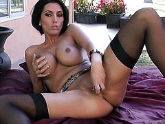 Dylan Ryder with huge melons and clean pussy strokes her pussy the way she loves it