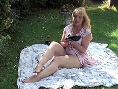 Milf on a solo picnic plays with her big tits and sexy ass