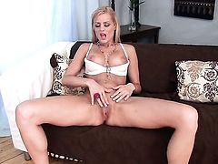 Chloe Conrad with smooth muff gives pleasure to herself using toy
