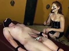 Slave gets his cock and balls tortured by his Mistress