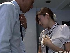 The principal is having a meeting with the science teacher, but she looks so hot in her skirt, blouse and nylons, that he can't keep his hands to himself. He has to bend her over and grab her firm ass from behind...