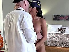 Johnny Sins is having his way with a stewardess. He is with her in a hotel room after an exhausting flight. She is helping him relax with her sexy tongue.
