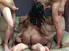 Nova is sandwiched in between two men. The ebony goddess is plowed hard from behind, while having a massive dick shoved down her throat. She can take any cock, no matter how massive it is. The black slut rides cock on the couch in this epic orgy.