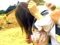 She likes it rough and in public. The boss on the construction site takes a break and ties this slut to his car. Mai has her hair pulled and gets spunk on her face. How humiliating for her to be used in the dirty sand pit.