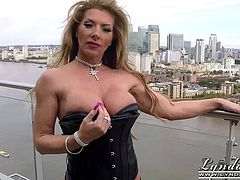 MILF with big tits flashes outdoors