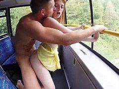 These two sluts climbed into a moving bus. After giving their lucky companion a hand job, the lusty redhead bends over to take it from behind. They take turns licking each other's wet slits and getting their pussies pounded, as the road rolls by.