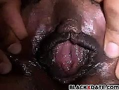 Ebony spreads her pussy close up