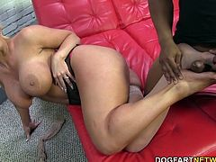 The busty, blonde cougar Alura Jenson gets her gorgeous feet fucked by Jon Jon's huge slab of black porn.